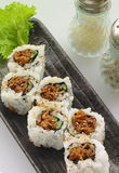 Minced beef SUSHI. Minced beef rolled in pita bread with a serving of fresh vegetables Stock Image