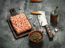 Minced beef with various spices and herbs. On a rustic background Stock Images