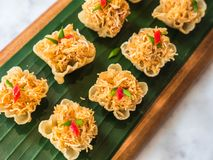 Thai traditional sweetmeat, Crispy Golden cup. Minced chicken and sweet corn in crispy Golden cup, Thai traditional sweetmeat Royalty Free Stock Image