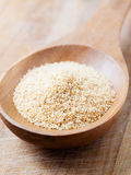 Minced garlic on a wooden spoon Royalty Free Stock Image