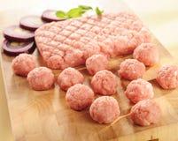 Minced ham. Arrangement on a cutting board. Raw minced meat of ham on a cutting board and vegetables stock photos