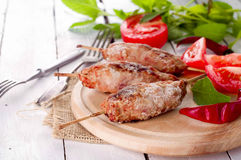 Minced lamb kebab. With vegetables and wine royalty free stock image