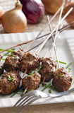 Minced meat. Balls on skewer Royalty Free Stock Photography