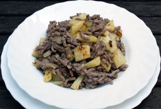 Minced meat. And potatoes served in a white dish Stock Images