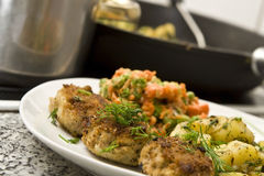 Minced meat. Pork burgers with potatoes, carrot and green peas Stock Photo