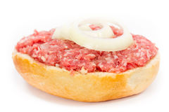 Minced meat. Bun with minced meat close up Stock Image