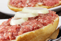 Minced meat. Bun with minced meat close up Royalty Free Stock Photos