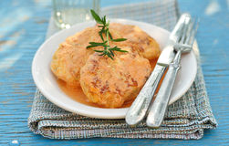 Minced meat and cabbage patties baked with tomato sauce Stock Photo