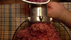 The minced meat. Closeup of fresh meat coming from old manual grinder stock video
