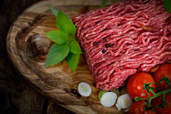 Minced meat. Cooking ingredients. Minced meat with tomato and spring onions stock images
