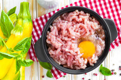 Minced meat with egg. In a bowl on a table Royalty Free Stock Photography