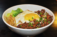 Minced meat and egg with rice. This is the signature dish by one of the popular restaurant in town stock photography