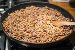 Minced meat in frying pan Royalty Free Stock Image