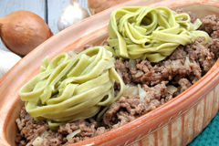 Minced meat with green ribbon noodles Royalty Free Stock Photos