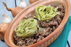 Minced meat with green ribbon noodles Stock Photography