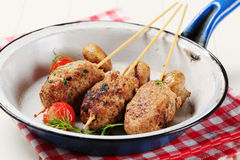 Minced meat kebabs. And pan roasted mushrooms Stock Images