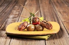 Minced meat kebabs and new potatoes. Minced meat kebabs on sticks and new potatoes Stock Images