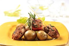 Minced meat kebabs and new potatoes Stock Photo