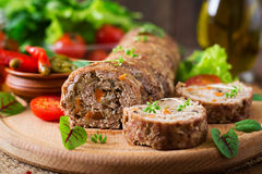 Minced meat loaf roll with mushrooms Stock Images