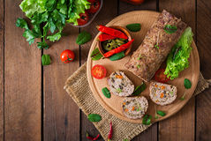 Minced meat loaf roll with mushrooms and carrots. Royalty Free Stock Image