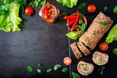 Minced meat loaf roll with mushrooms and carrots. Royalty Free Stock Images