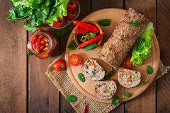 Minced meat loaf roll with mushrooms and carrots. Stock Photography