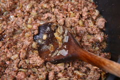 Minced meat and onion being fried Stock Images
