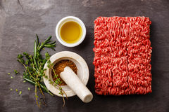 Minced meat with pepper, oil and herbs Stock Photo