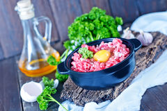 Minced meat. And raw egg in bowl and on a table Stock Photo