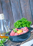 Minced meat. And raw egg in bowl and on a table Stock Images
