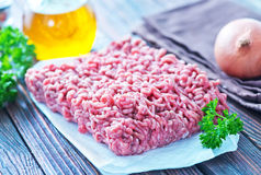 Minced meat. Raw minced meat on the wooden board Stock Photography