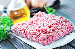 Minced meat. Raw minced meat on the wooden board Stock Images