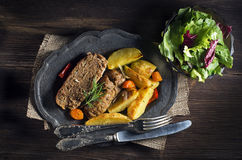 Minced meat. Roasted minced meat with potatoes and salad close up stock photo