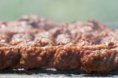 Minced meat rolls on grill (traditional Romanian food) – mititei, mici Royalty Free Stock Photography