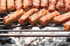 Minced meat rolls on grill (traditional Romanian food) – mititei, mici Royalty Free Stock Images