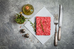 Minced meat with seasoning and fresh thyme Stock Photo