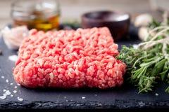 Minced meat on a slate stone black board. Stock Image
