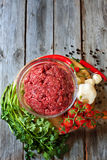 Minced meat with vegetables. Minced meat, chili pepper, cherry tomato, cilantro and garlic - traditional ingredients of mexican cuisine. Copyspace background Stock Images