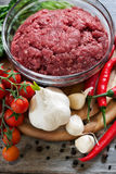 Minced meat with vegetables. Minced meat, chili pepper, cherry tomato and garlic. Selective focus Stock Photo