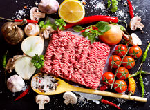 Minced meat with vegetables. On dark board Royalty Free Stock Photography