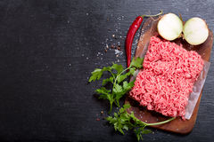 Minced meat with vegetables. On dark board Stock Photo
