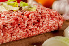 Minced meat. With vegetables on wood plate Royalty Free Stock Photos