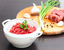 Minced meat in a white bowl with fresh herbs Stock Images