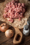 Minced meat on wooden background. Royalty Free Stock Photo