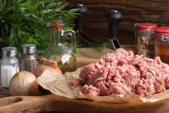 Minced meat on wooden background. Royalty Free Stock Photos