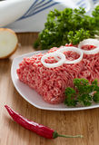 Minced meat on the wooden cutting board Stock Photos