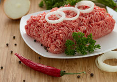 Minced meat on the wooden cutting board Stock Photo