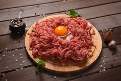 Minced meat on a wooden desk. Minced meat on a rustic wooden desk Royalty Free Stock Images