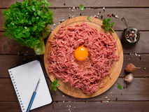 Minced meat on a wooden desk Stock Photos