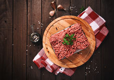 Minced meat on a wooden table. Minced meat on a rustic wooden table. Top view Stock Photography